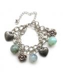 Bransoletka w kolorze srebra i pistacji Bransoletka ze szklanymi kulkami na łańcuszku